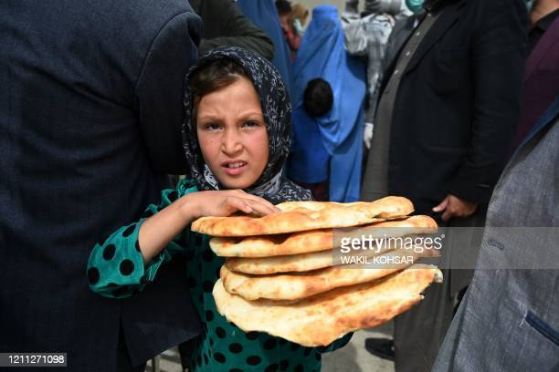 A young girl leaves after receiving free bread from the municipality outside a bakery during the Islamic holy month of Ramadan as governmentimposed a...