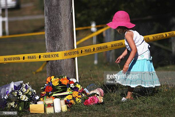 A young girl leaves flowers for murdered Scottish tourist Karen Aim at the site of her death near Taupo's NuiaTia College on January 18 2007 in Taupo...