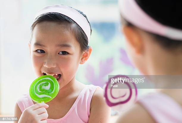Young Girl Licking Lollipop