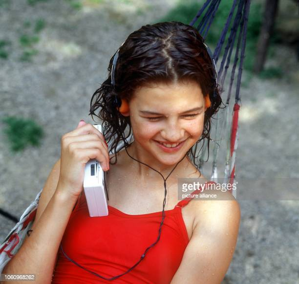 Young girl listens to music with her walkman .
