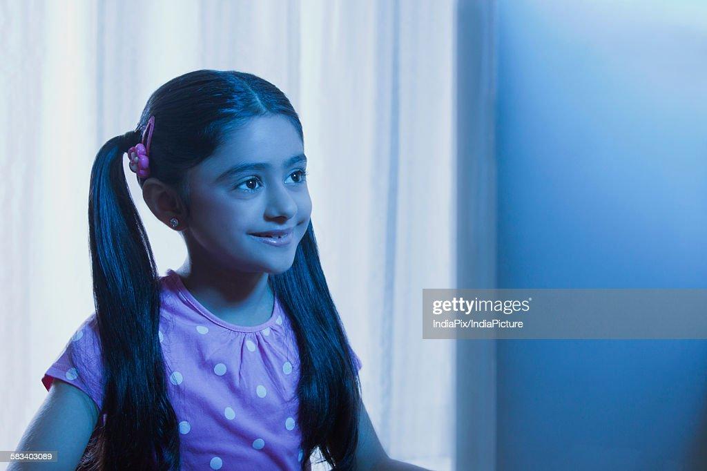 Young girl looking at a computer monitor : Stock Photo