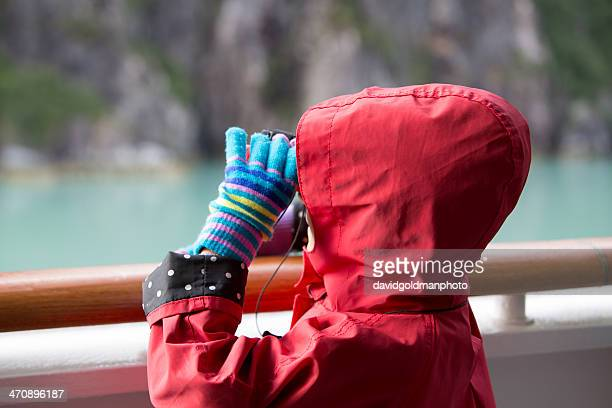 Young girl looking at glacier in Alaska from cruise ship, Ketchikan, Alaska, USA