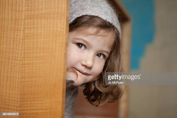 Young girl looking at you