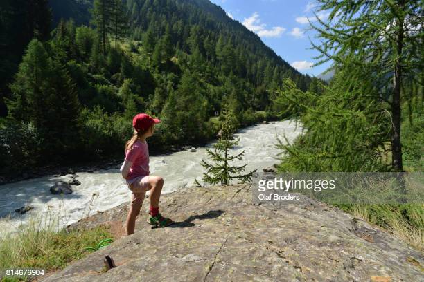 Young girl looking on Alpine valley