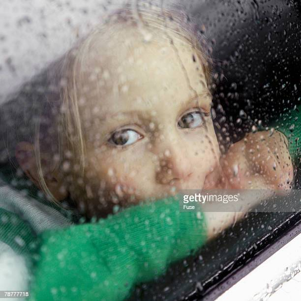 young girl looking out - sadgirl stock pictures, royalty-free photos & images