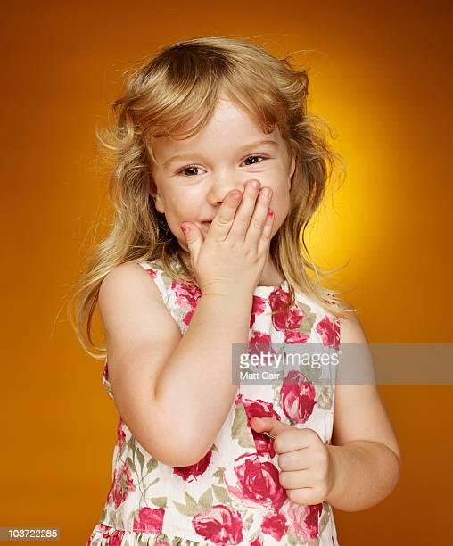 young girl looking shy - floral pattern dress stock pictures, royalty-free photos & images