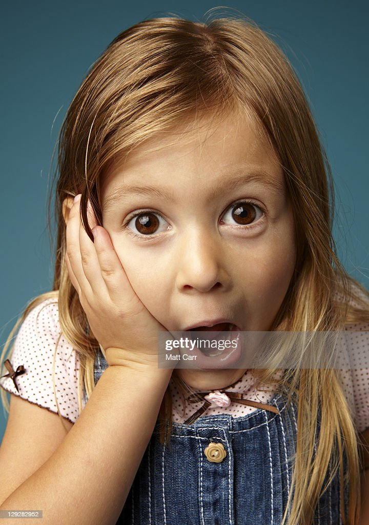 Young Woman Looking Surprised Stock Photo - Download Image