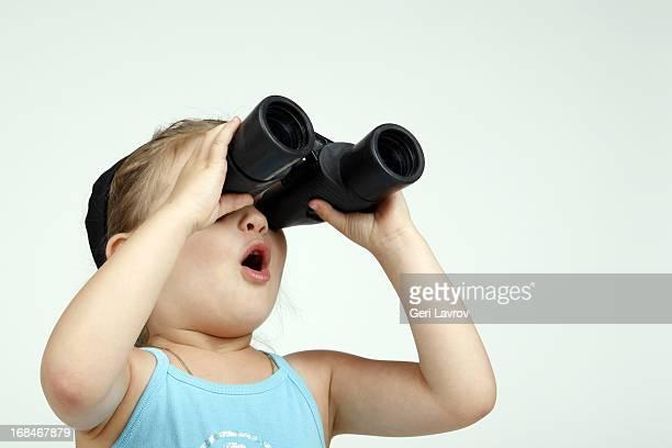Young girl looking through binoculars