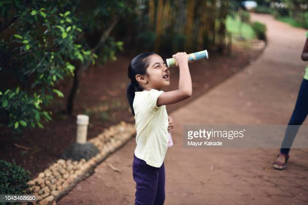 Young girl (4-5 years) looking through Kaleidoscope
