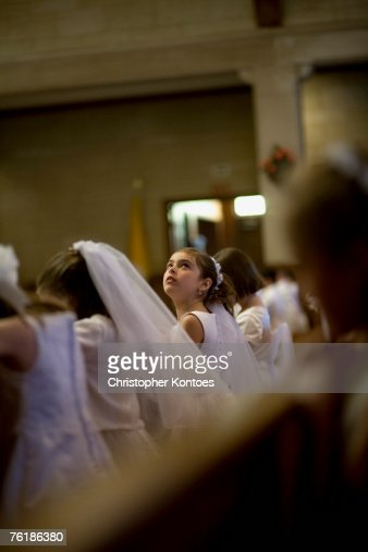 A young girl looking up at her holy communion ceremony