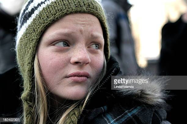 Young Girl Looking Worried and Alone in the City