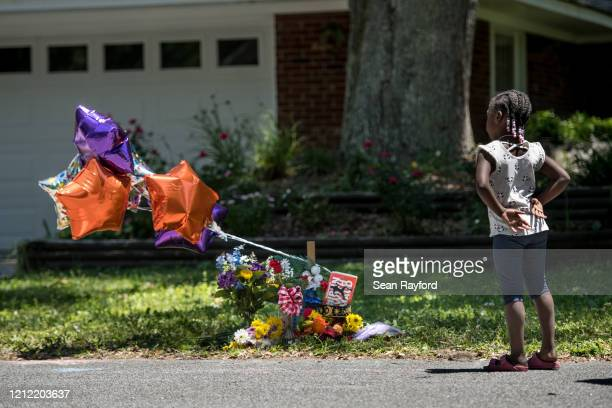 Young girl looks at a memorial for Ahmaud Arbery near where he was shot and killed May 8, 2020 in Brunswick, Georgia. Gregory McMichael and Travis...
