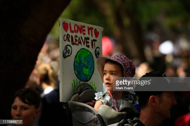 Young girl looks on as thousands of school students and protestors participate in a Climate strike rally on September 20, 2019 in Sydney, Australia....