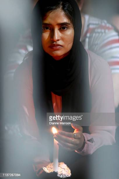 A young girl looks on during the vigil held at Forsyth Barr Stadium on March 21 2019 in Dunedin New Zealand 50 people were killed and dozens were...