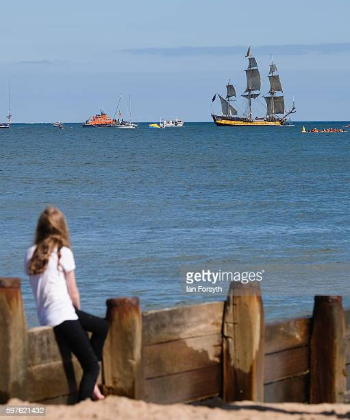 A young girl looks on from the beach as the Russian ship Shtandart leaves Blyth harbour during the North Sea Tall Ships Parade of Sail on August 29...