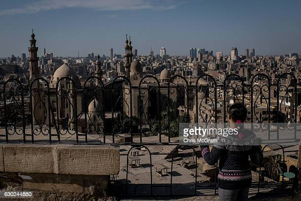 A young girl looks out over the Cairo skyline on December 16 2016 in Cairo Egypt Since the 2011 Arab Spring Egyptians have been facing a crisis the...