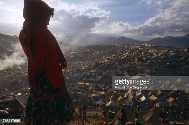 A young girl looks over the masses of tents set up in a Kurdish refugee camp in Iraq following Operation Desert Storm Hundreds of thousands of Kurds...