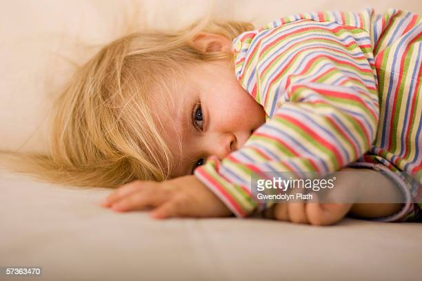 Young girl lying down on sofa