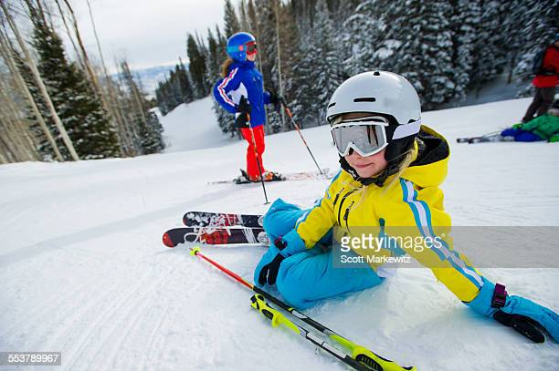young girl lying down on the slopes - park city utah stock pictures, royalty-free photos & images