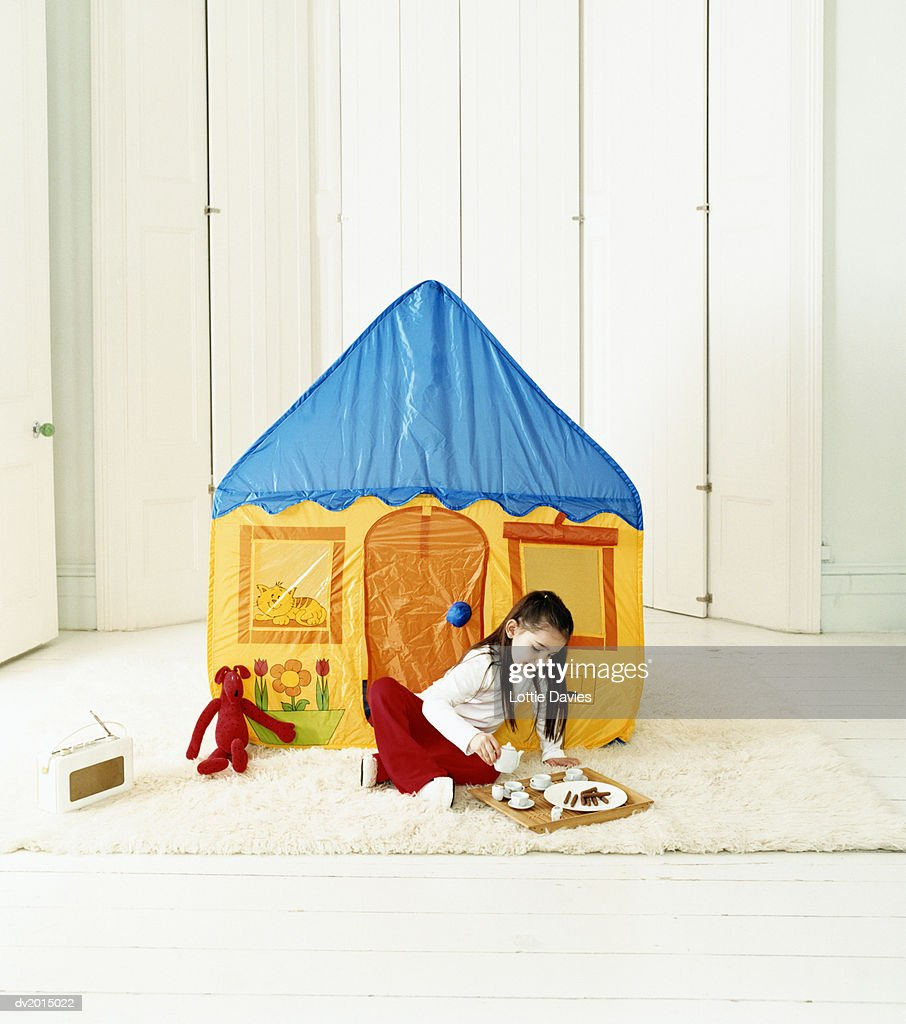 Young Girl Lying in a Playhouse : Stock Photo