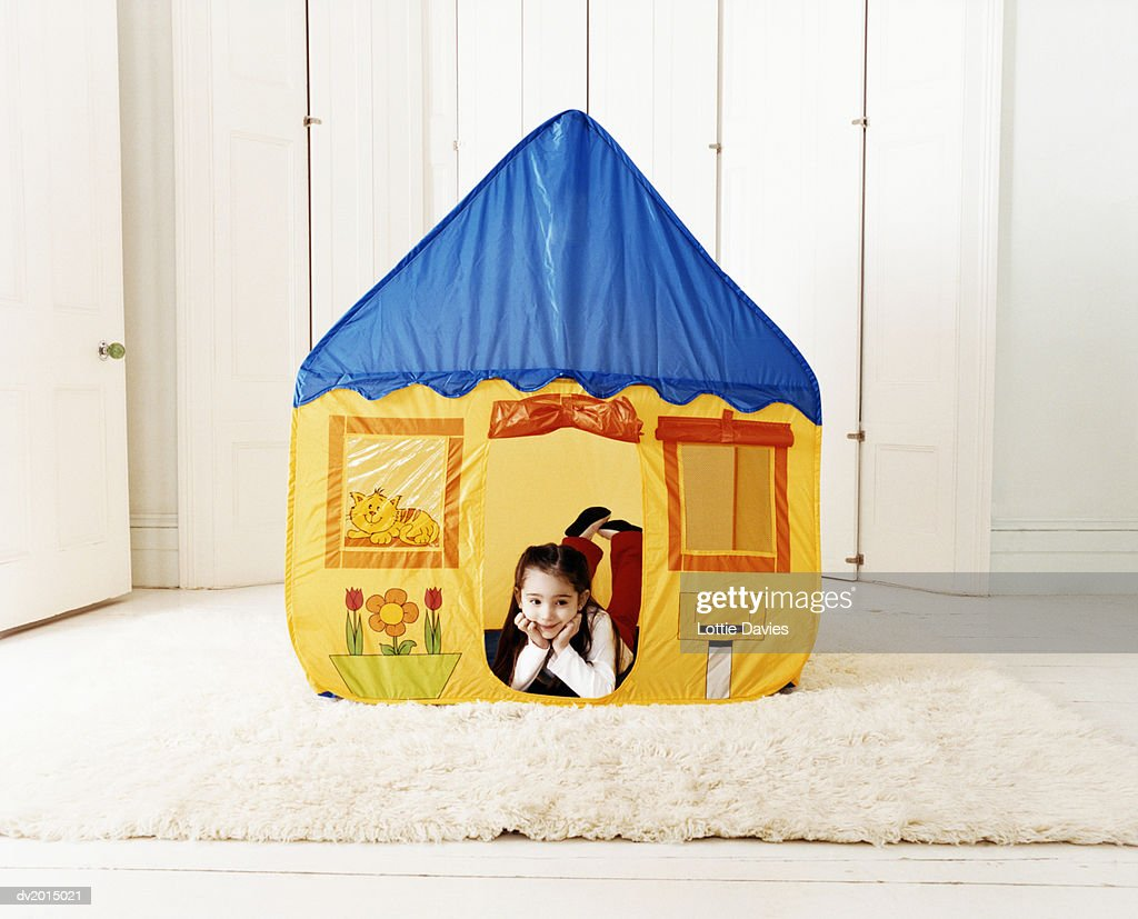 Young Girl Lying Inside a Playhouse : Stock Photo
