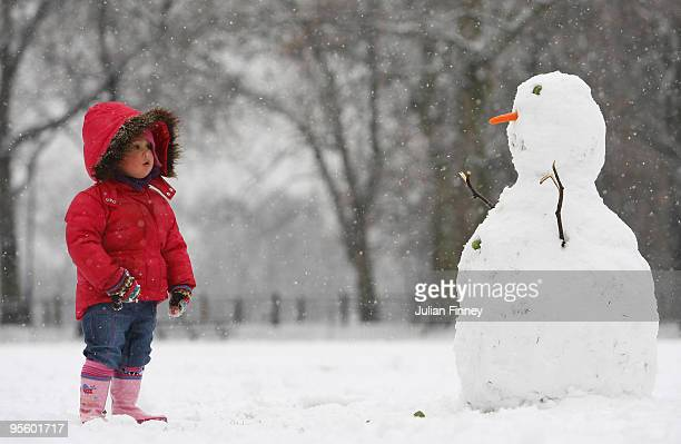 A young girl makes a snowman at Highbury Fields on January 6 2010 in London Extreme weather warnings have been issued across England as heavy...