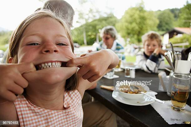 Young girl making a grimace