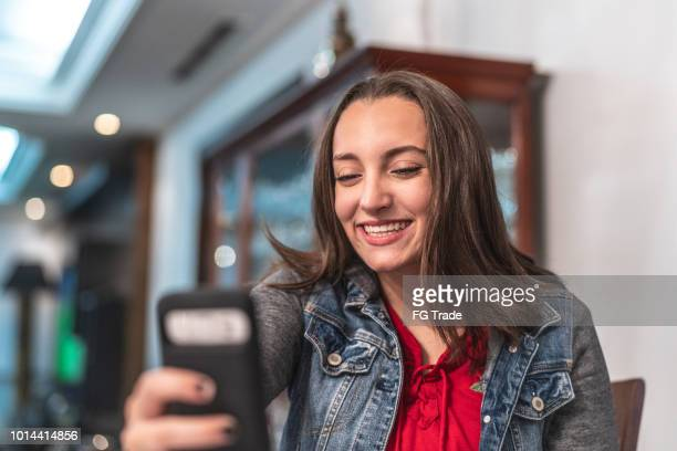 young girl making a video chat at home - very young webcam girls stock photos and pictures