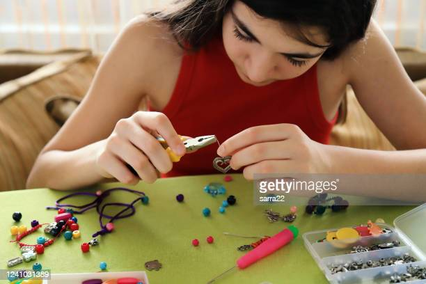 young girl making bead bracelets - bead stock pictures, royalty-free photos & images