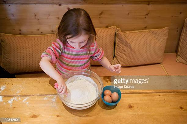 Young girl making cake