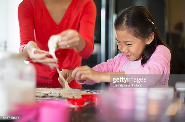 Young girl making cookies with cookie dough