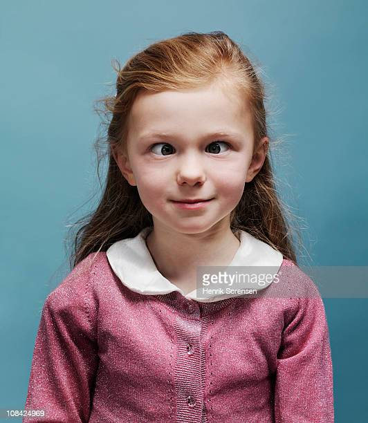 Young girl making herself cross eyed