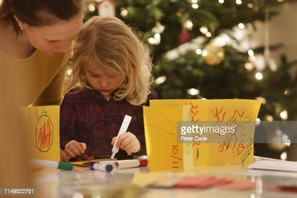 young girl making homemade christmas cards - making stock pictures, royalty-free photos & images