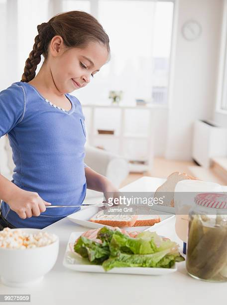 Young girl making sandwich