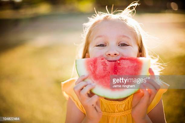young girl making smile with watermelon - watermelon stock pictures, royalty-free photos & images