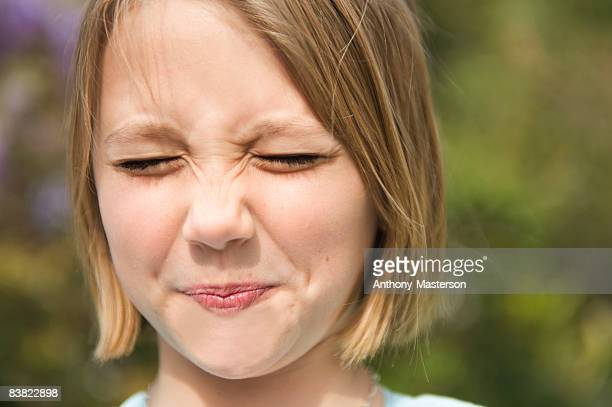 Young girl making sour face