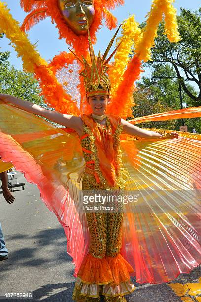 A young girl marches in an elaborately conceived costume Massive crowds gathered along the Eastern Parkway in Crown Heights Brooklyn to witness the...