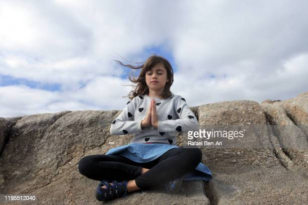young girl meditating outdoors - rafael ben ari imagens e fotografias de stock