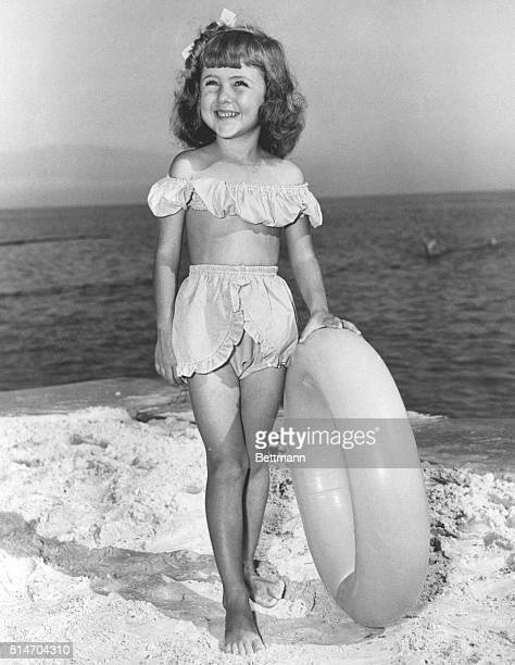 6/10/1949 Young girl models bathing suit on beach