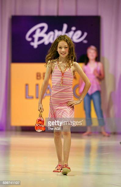 A young girl models on the catwalk for the 'Barbie' by Bettina Liano fashion show in Melbourne 21 September 2005 THE AGE Picture by NICOLE EMANUEL