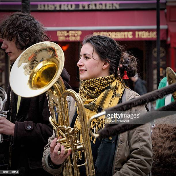 Young girl musician with a yellow scarf in Paris