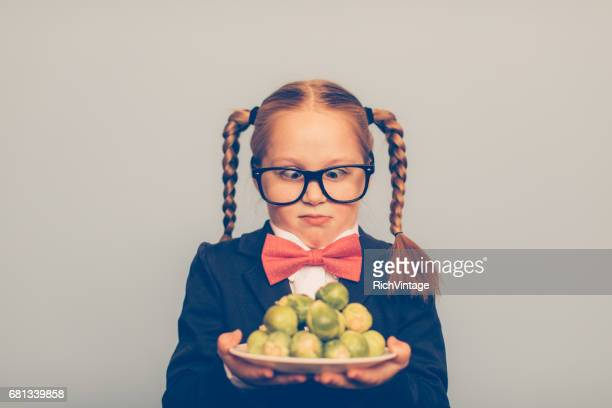 Young Girl Nerd with Brussels Sprouts