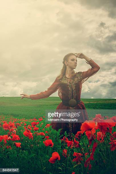 young girl on a field of poppies - long dress stock pictures, royalty-free photos & images