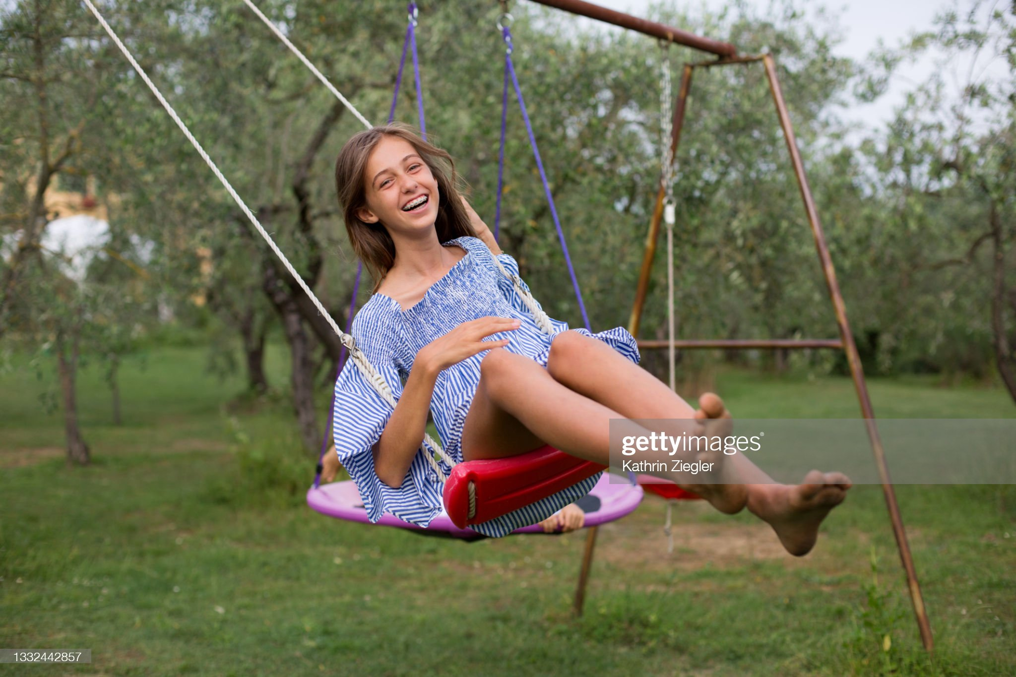 https://media.gettyimages.com/photos/young-girl-on-a-swing-laughing-picture-id1332442857?s=2048x2048