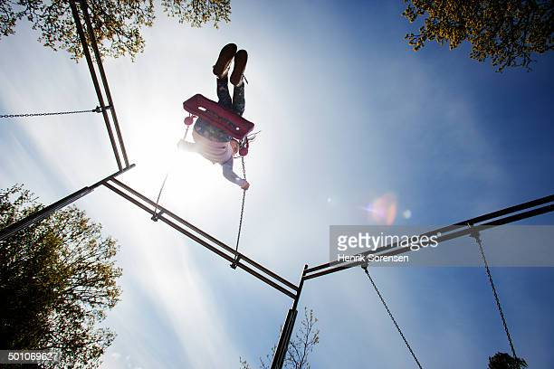 young girl on a swing - low angle view stock pictures, royalty-free photos & images