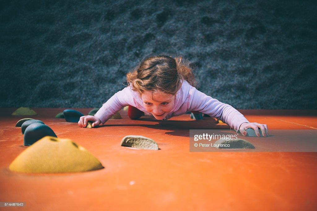 Young girl on climbing wall : Stock Photo