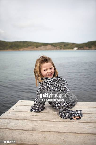 young girl on edge of jetty - heidi coppock beard bildbanksfoton och bilder
