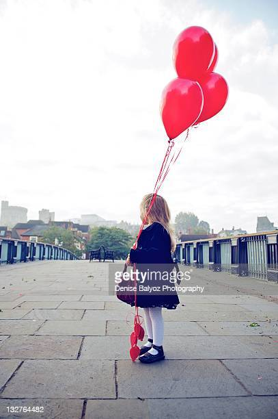 Young Girl on Eton Bridge with Red Balloons