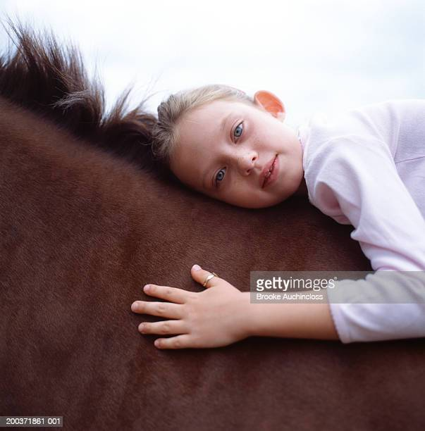 Young girl on horse, portrait