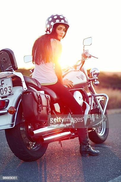 young girl on mototrcycle at sunset